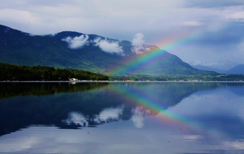 Calm Morning Water Reflecting a Rainbow